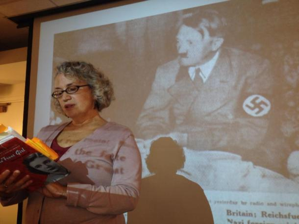 Reading a section of Home Front Girl in front of an image from Joan's diary:  a clipping from the newspaper during the appeasement talks in September 1938