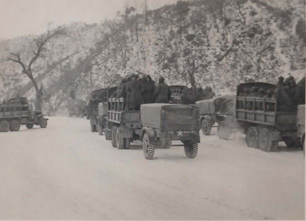 "Rachael writes:  ""My grandfather's caption reads: The Road Back after endless months in Korea. The trip to Chuncheon has begun and the convoy eagerly starts rolling despite the freezing weather, Jan '52."""