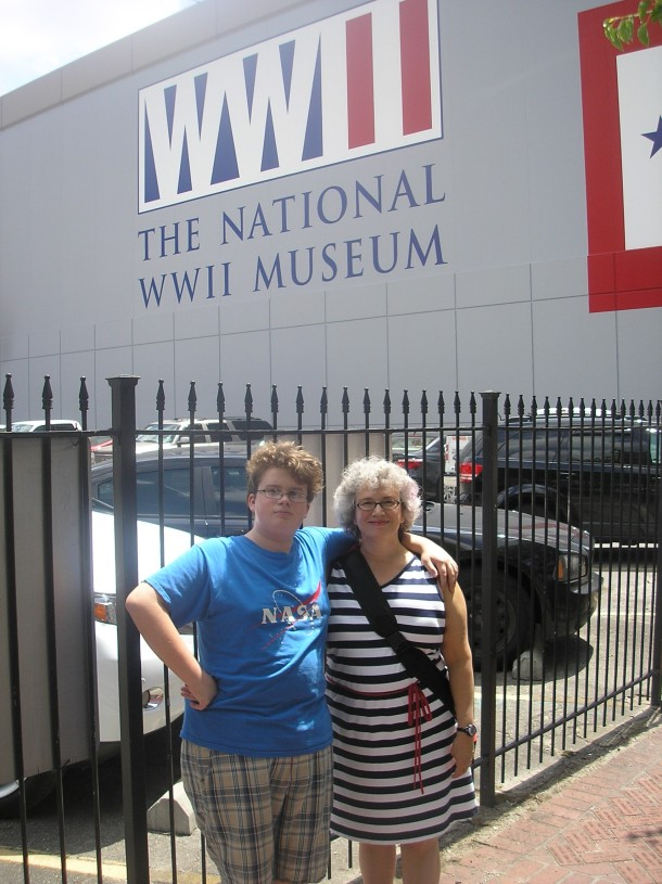 With John in front of the National World War II Museum, New Orleans.  Photo by Jim Kilfoyle.