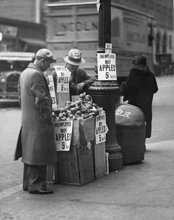 Apple Sellers in Depression.  From http://www.britannica.com/EBchecked/media/97369/Man-selling-apples-during-the-Great-Depression
