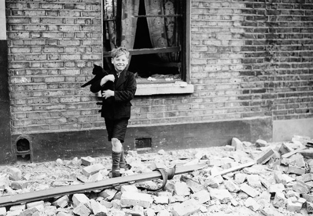 A boy with a cat in London during the blitz, 1940