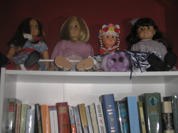 The Four Fates: Emily, Kit, a doll from Poland, and Samantha.  A little stuffed bug (representing the disease 'mono') sits in front.