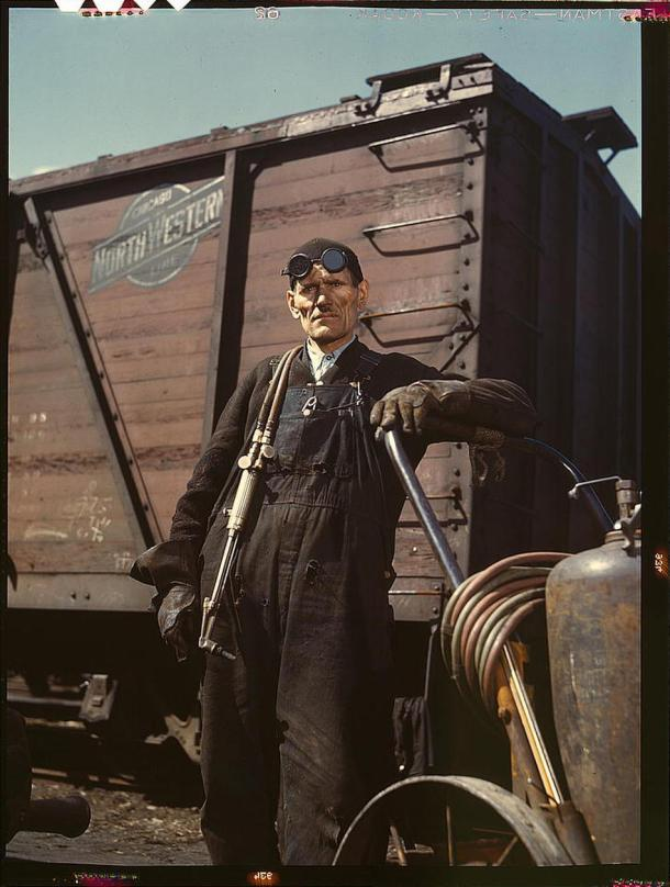Mike Evans, a welder, at the rip tracks at Proviso yard of the Chicago and Northwest Railway Company. Chicago, Illinois, April 1943