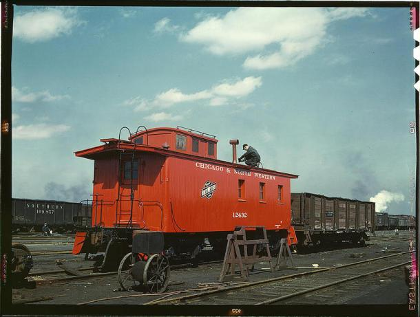 Putting the finishing touches on a rebuilt caboose at the rip tracks at Proviso yard. Chicago, Illinois, April 1943.