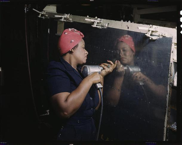 "Woman is working on a ""Vengeance"" dive bomber Tennessee, February 1943. Reproduction from color slide."