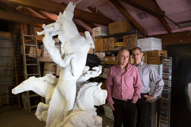 Dr. Roy Goldberg at left and Keith Sherman at the right next to their plaster model of a statue from the 1939 World's Fair in Queens. Credit James Estrin/The New York Times .